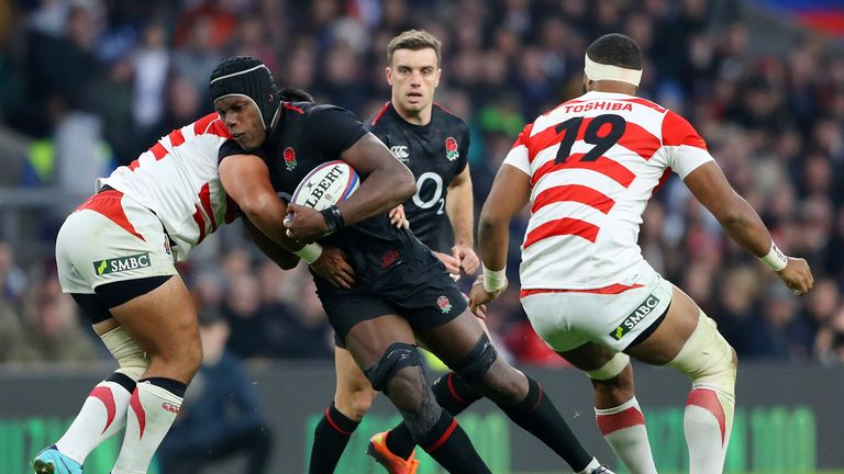 Maro Itoje carries the ball into Japan's defence
