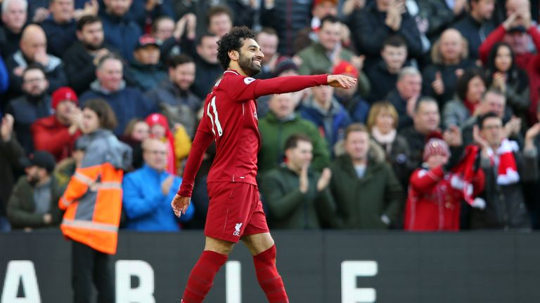 Mohamed Salah celebrates after scoring the opener