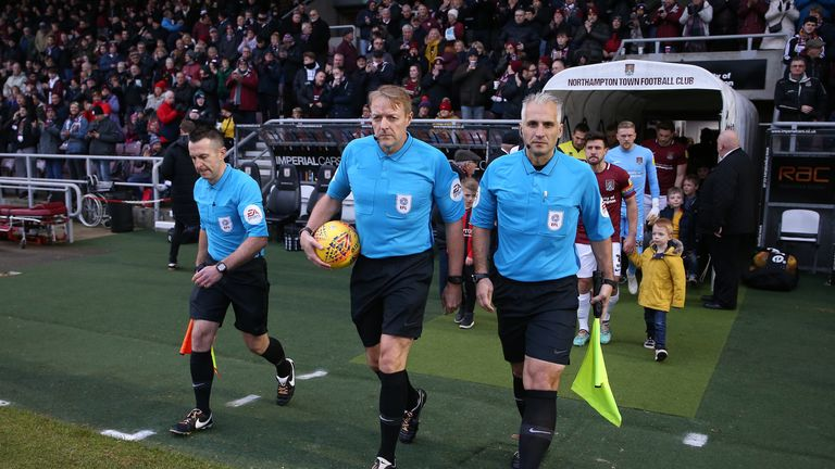 Referee Trevor Kettle and his assistants Paul Kelly (L) and Ravel Cheosiaus were all wearing Rainbow Laces at Sixfields