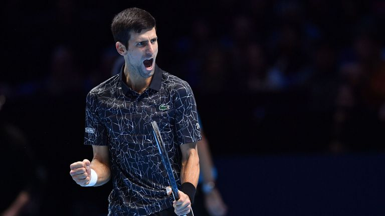 Novak Djokovic reacts after winning a game during their men's singles semi-final match against South Africa's Kevin Anderson on day seven of the ATP World Tour Finals tennis tournament at the O2 Arena in London on November 17, 2018.