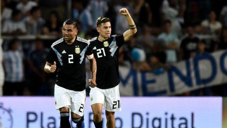 Paulo Dybala (R) celebrates scoring for Argentina