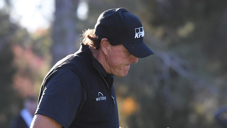 Mickelson defeated Woods at the fourth extra hole