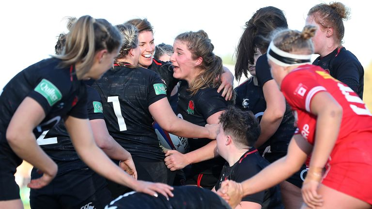 Poppy Cleall celebrates her try against Canada,