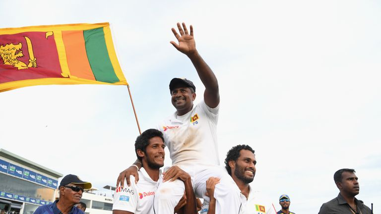Herath is carried off the Galle pitch by his Sri Lanka team-mates