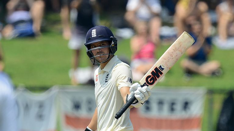 Rory Burns raises his bat after scoring his maiden Test fifty for England