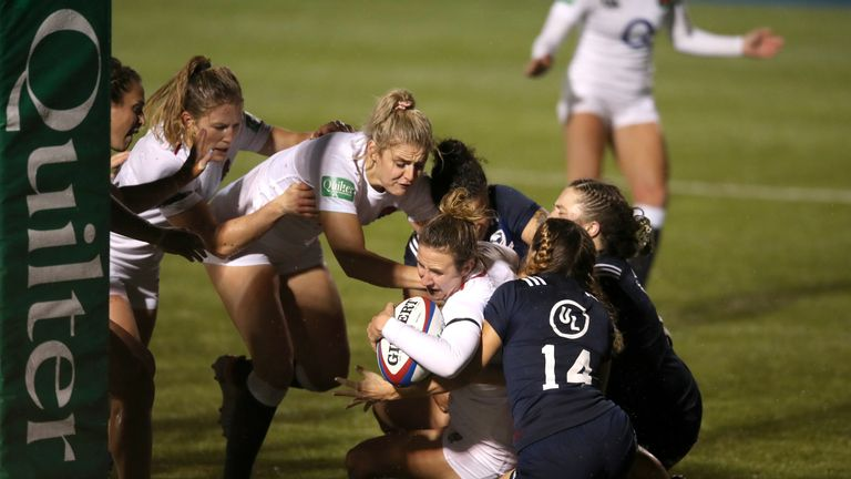 England's Sarah McKenna dives in to score