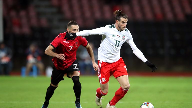 Albania's Eros Grezda (left) and Wales' Gareth Bale (right) battle for the ball