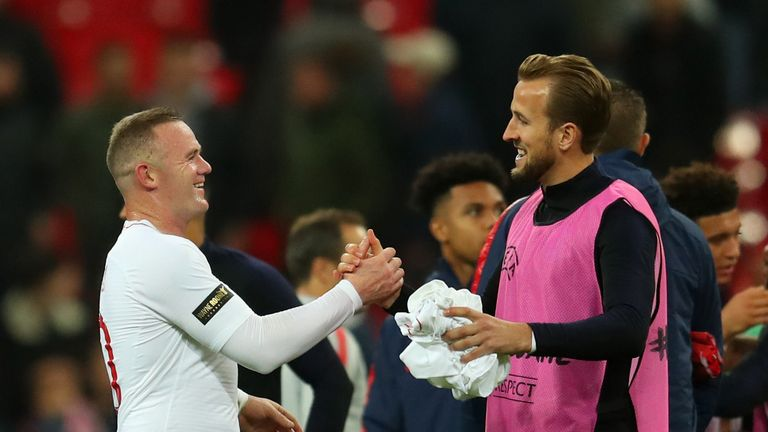 Wayne Rooney shakes hands with Harry Kane at full-time