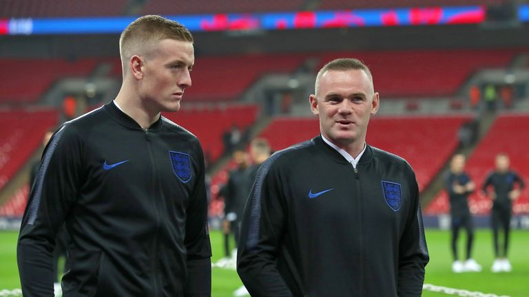England's Wayne Rooney (right) speaks with Jordan Pickford before the International Friendly at Wembley Stadium, London