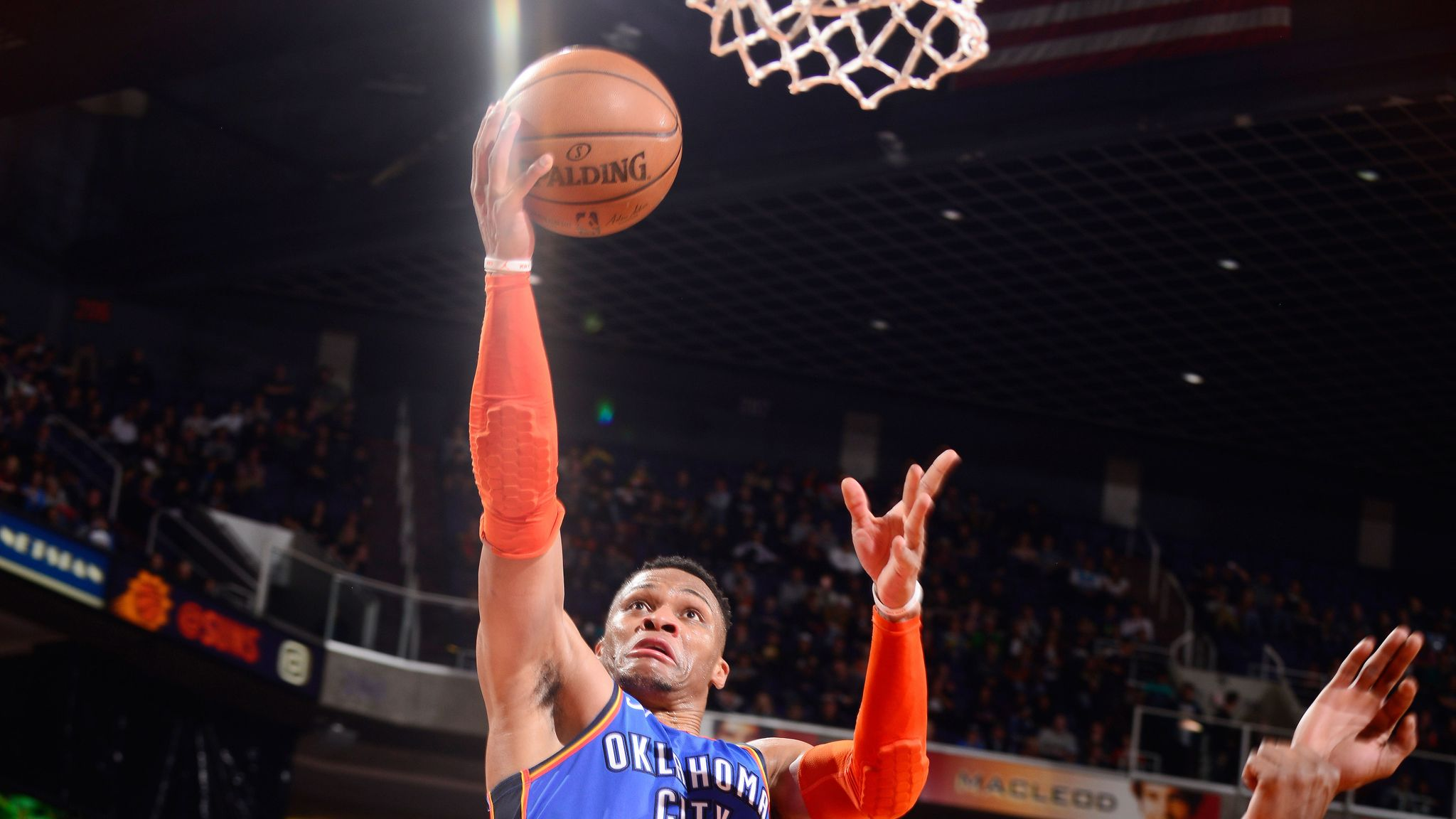 Russell Westbrook scores with a lay-up against Phoenix