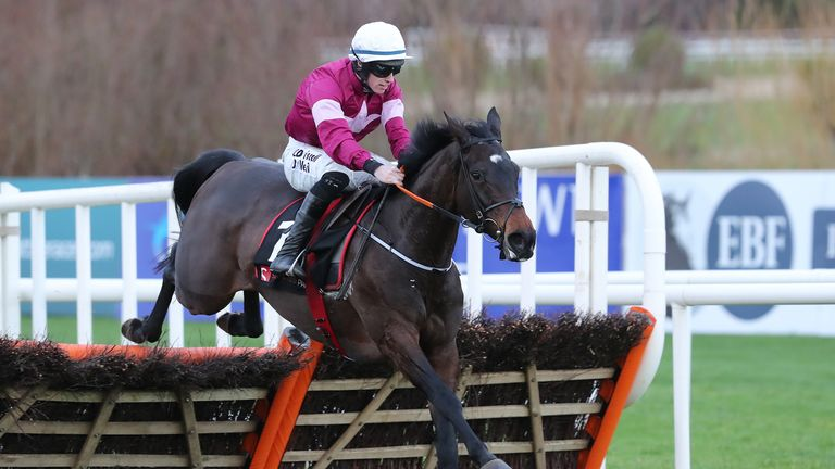 Apple's Jade, ridden by Jack Kennedy, jumps the last before going on to win the Squared Financial Christmas Hurdle