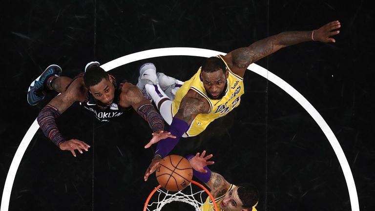 LeBron James fights for a rebound against Brooklyn
