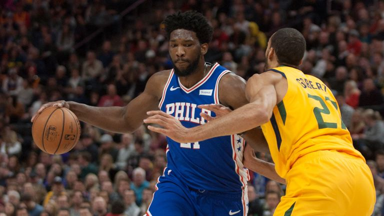 Joel Embiid backs down Gobert