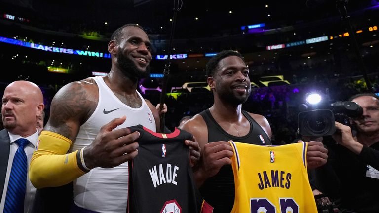 LeBron James and Dwyane Wade swap jerseys after facing off for the final time
