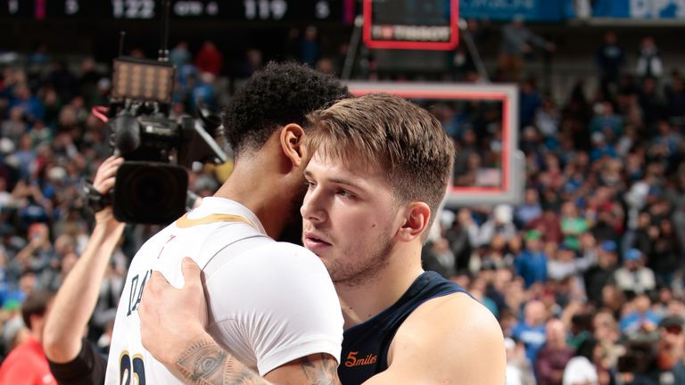 Luca Doncic is congratulated by Anthony Davis