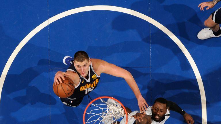 Nikola Jokic pulls down a rebound