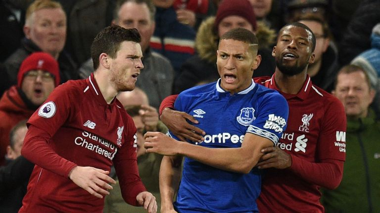 Andrew Robertson and Richarlison clash