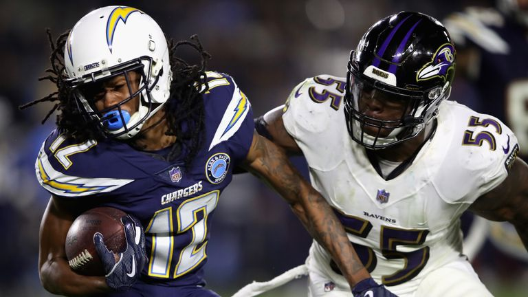 Terrell Suggs gets after Chargers receiver Travis Benjamin as the Ravens win on the road