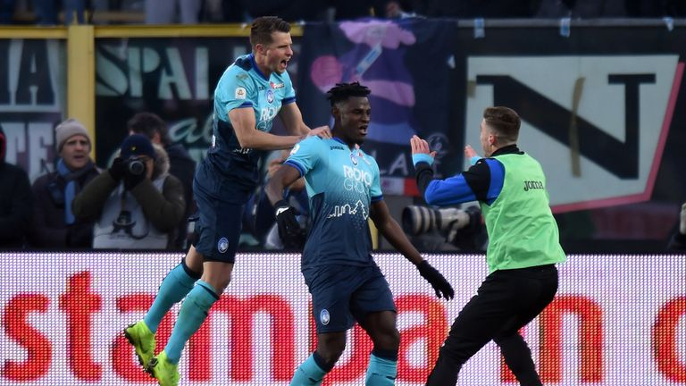 Duvan Zapata is mobbed after his double put Atalanta in control