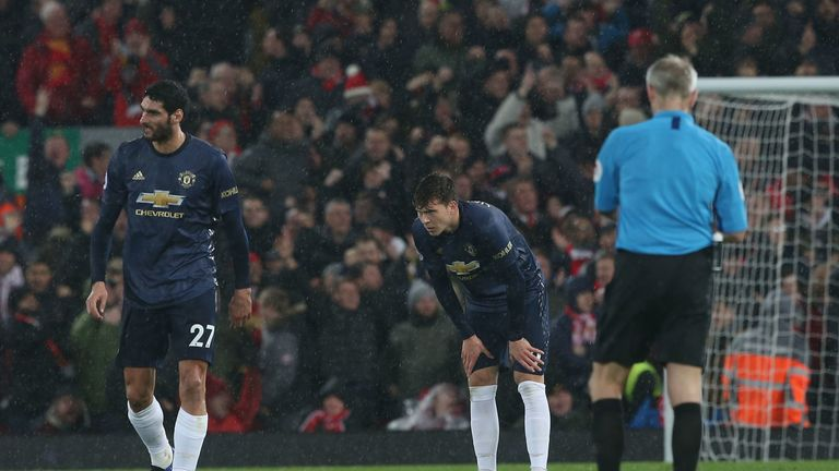 Marouane Fellaini and Victor Lindelof show the strain after Liverpool score again