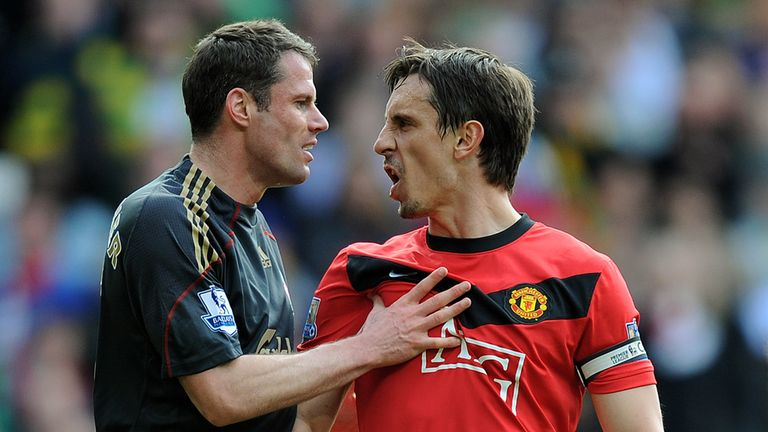 Gary Neville and Jamie Carragher during the Barclays Premier League match between Manchester United and Liverpool at Old Trafford on March 21, 2010 in Manchester, England.