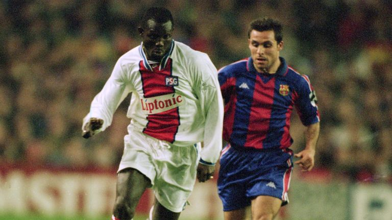 George Weah in action for Paris Saint-Germain against Sergi of Barcelona in 1995