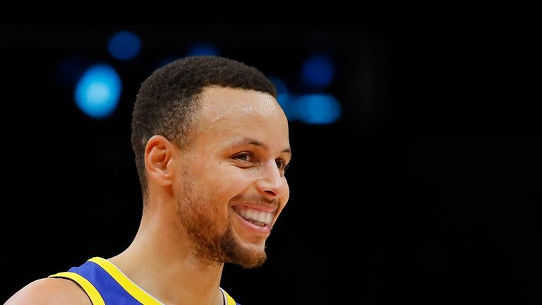 Stephen Curry of the Golden State Warriors reacts after hitting a three-point basket against the Atlanta Hawks
