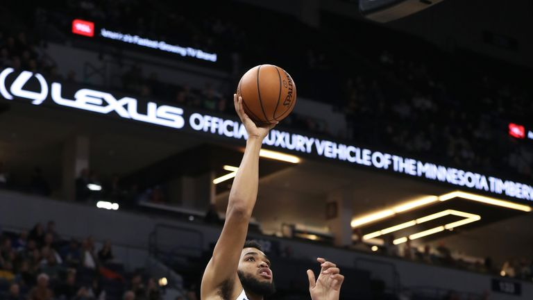 Karl-Anthony Towns #32 of the Minnesota Timberwolves shoots the ball against the Charlotte Hornets on December 5, 2018 at Target Center in Minneapolis, Minnesota.