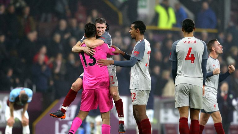 Alisson, James Milner and Joel Matip celebrate as Liverpool moved two points behind leaders Manchester City