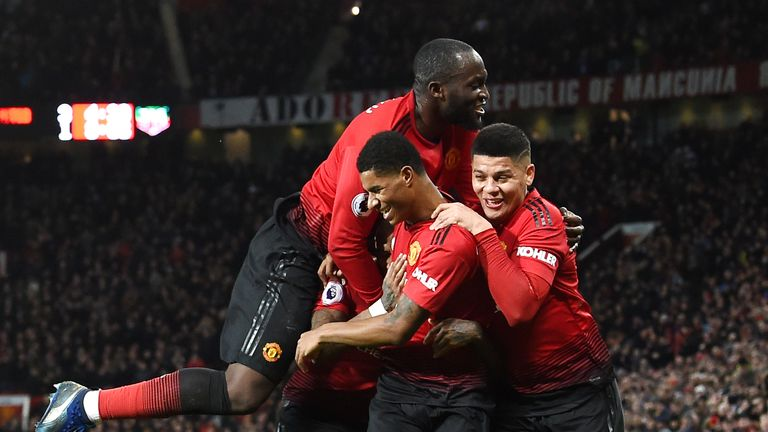 Marcus Rashford celebrates his goal with team-mates