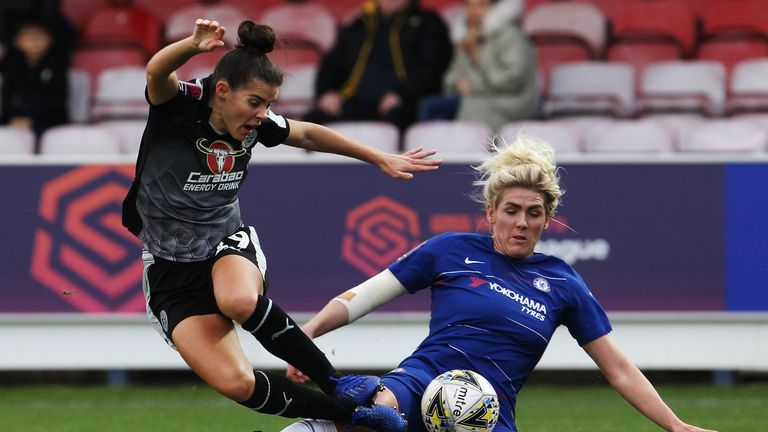 Millie Bright slides in on Reading's Brooke Chaplen in their 2-0 win
