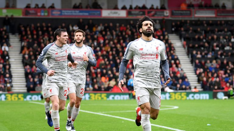 Mohamed Salah celebrates after scoring his hat-trick
