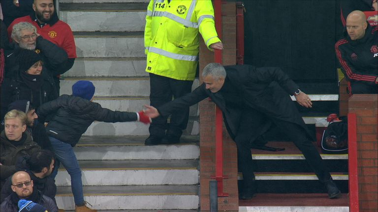 Jose Mourinho had a lighthearted moment with a young Manchester Utd fan, offering him a high-five after kicking a wall in anger.