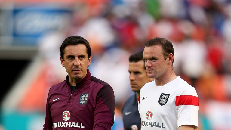 Neville compared the abuse Sterling received to the treatment Wayne Rooney (R) got during his England career