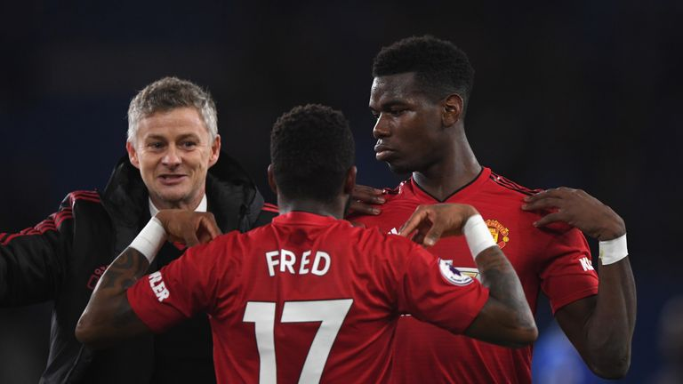 Ole Gunnar Solskjaer celebrates with Fred and Paul Pogba after Manchester United's Premier League win at Cardiff