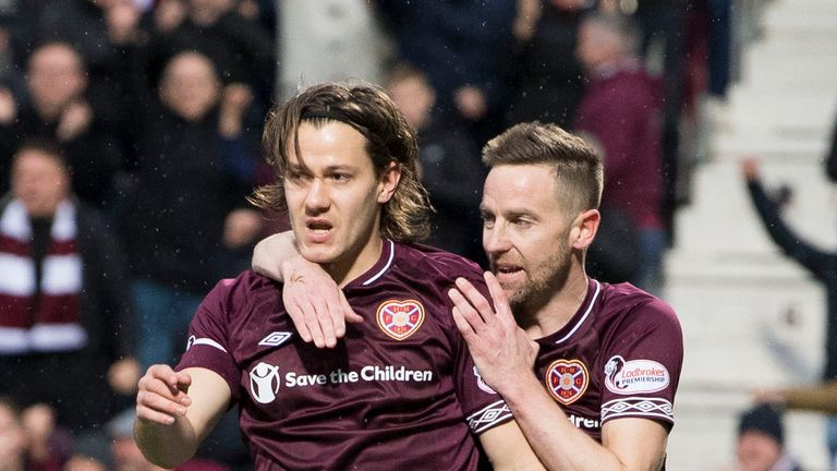 Hearts' Peter Haring (L) celebrates his goal with team-mate Steven MacLean