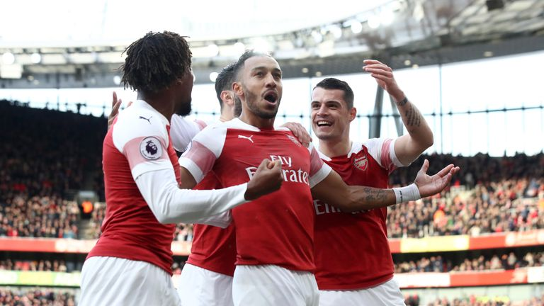 Pierre-Emerick Aubameyang celebrates with team-mates after opening the scoring