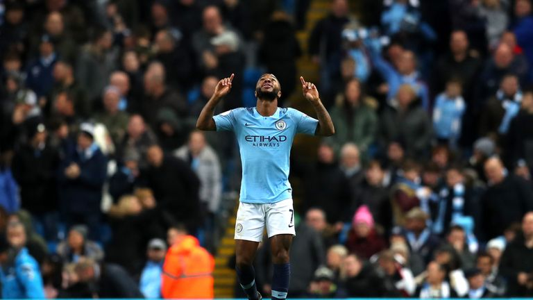 Raheem Sterling celebrates scoring Manchester City's second goal