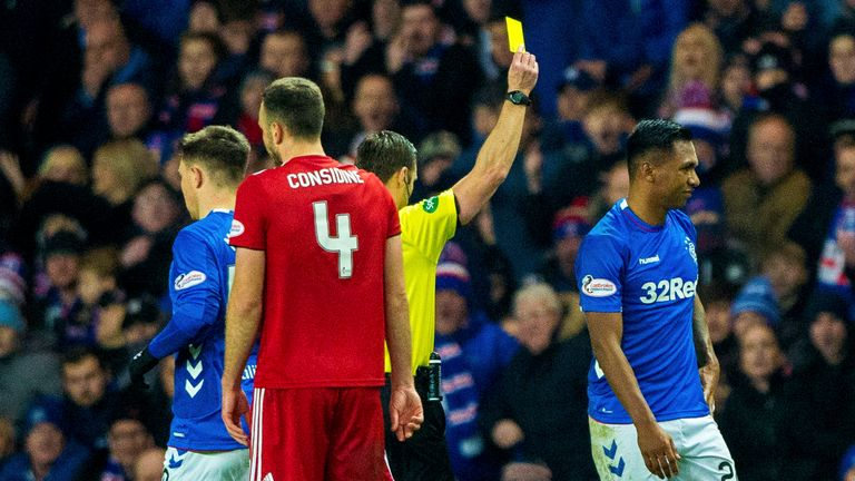 Rangers' Alfredo Morelos receives a yellow card from referee Steven McLean