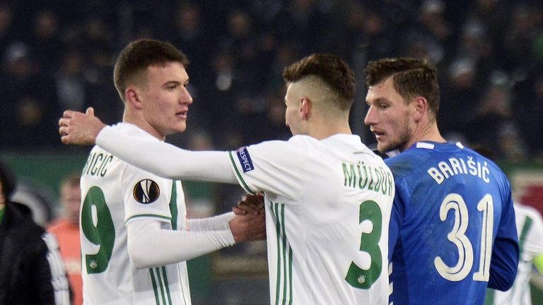 Rapid Wien's Austrian midfielder Dejan Ljubicic is congratulated by teammates Turkish defender Mert Muldur after scoring his team's first goal during the UEFA Europa League Group G football match between Rapid Wien and Glasgow Rangers on December 13, 2018 in Vienna.