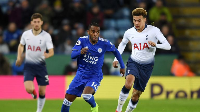 Ricardo Pereira runs past Alli during the match at the King Power Stadium