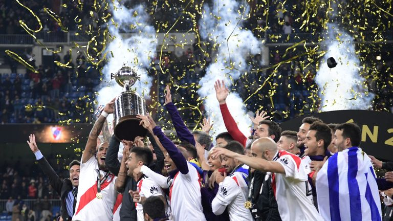 River Plate players celebrate with the trophy at the Bernabeu