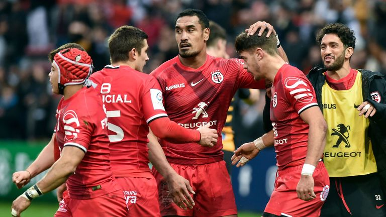 Romain Ntamack is congratulated by his Toulouse team-mates after scoring a try