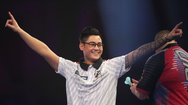 Rowby-John Rodriguez celebrates his win during day six of the William Hill World Darts Championships at Alexandra Palace, London. PRESS ASSOCIATION Photo. Picture date: Tuesday December 18, 2018. Photo credit should read: Adam Davy/PA Wire
