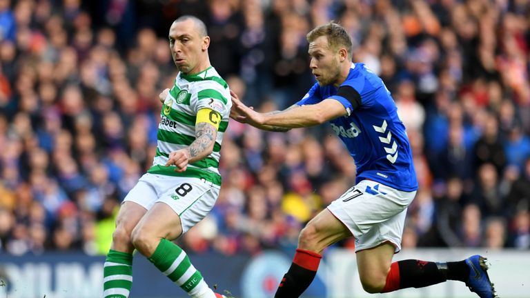 Brown clears the ball from Rangers' Scott Arfield