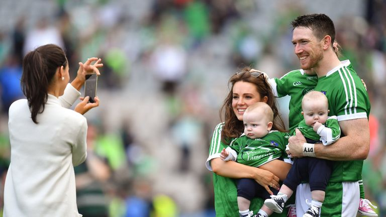 Hickey celebrates with his family in Croke Park after the final win over Galway