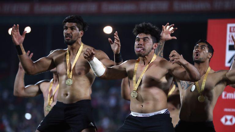 The New Zealand squad perform a Haka having won the final of the Dubai Sevens