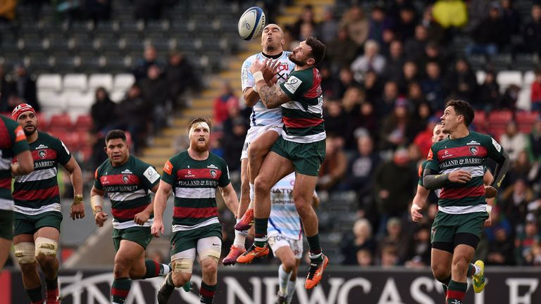 Simon Zebo and Adam Thompstone compete for the high ball