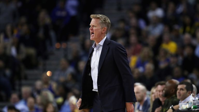 Golden State Warriors head coach Steve Kerr stands on the side of the court during their game against the Milwaukee Bucks