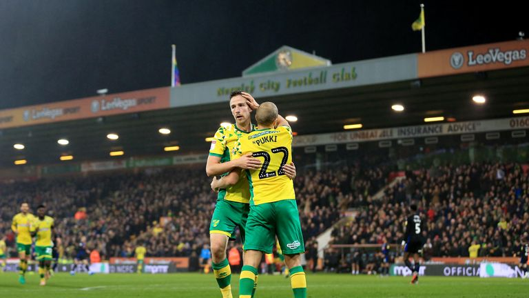Teemu Pukki is congratulated after stretching Norwich's lead